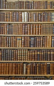 Antique books stacked on shelves
