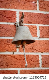 Antique brass bells strung hanging on the wall