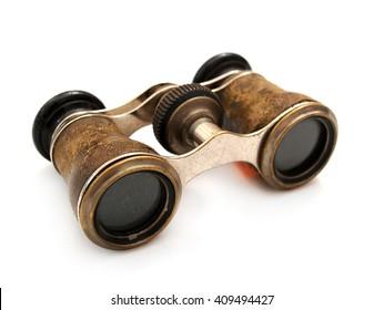 Antique brass binoculars at white background