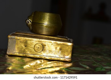 Antique brass box and a small chest.