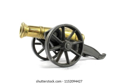 Antique Brass Canon on Wheels on White background