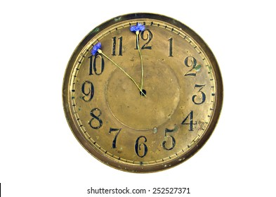 antique brass clock dial with cornflowers arrows isolated on white. Summer time concept