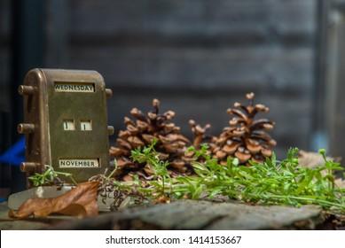 Antique Brass Desktop Perpetual Calendar on an Old wooden floor.