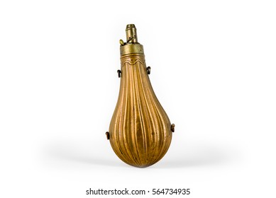 Antique brass powder flask on a white background