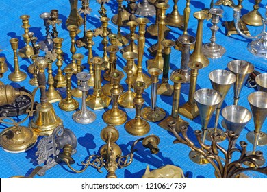 Antique bronze and brass candle holders for sale at flea market