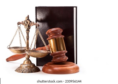 Antique bronze scales, gavel and book on white background