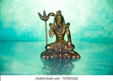 Antique bronze Shiva statue on blue  background