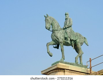 Antique bronze statue of king Leopold 2 on his horse against blue sky in Ostend, Belgium