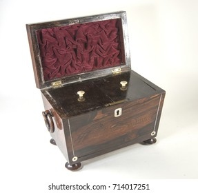 Antique brown box with red interior, white carved button pulls on individual holders with brass fixtures and wooden ring handles.  fixtures and wood handles on white background