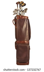 Antique brown leather bag with steel and wooden golf clubs isolated on a white background