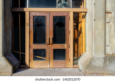 Antique building double doors with windows and faded paint