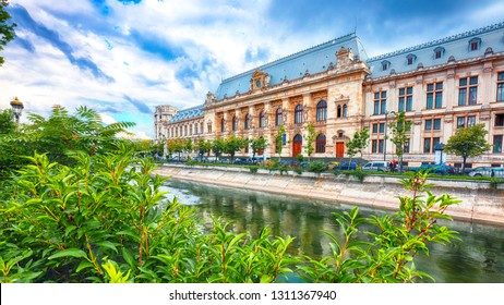 Antique building view in Old Town Bucharest city - capital of Romania and Dambrovita river. Bucharest, Romania, Europe.