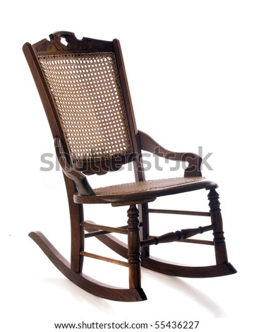 An Antique Cane Rocking Chair Isolated On White.