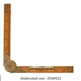 Antique carpenter's boxwood folding rule of 19th century marked Rabone with brass level and protractor isolated on white