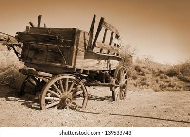 Antique carriage use during far west time in a meadow in sepia