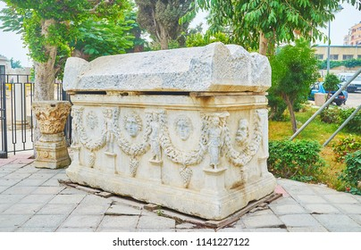 The antique carved sarcophagus at the entrance to Catacombs of Kom El Shoqafa archaeological site, containing objects of Pharaonic, Greek and Roman funeral cult, Alexandria, Egypt.