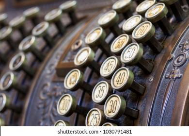 Antique cash register, buttons close up