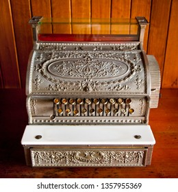 Antique Cash Register. Vintage till used to calculate prices. Old fashioned mechanical metal machine with keys draw and display.