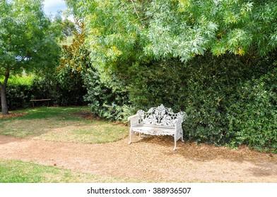 Antique cast iron bench at Amaze'n Margaret River/Antique Bench/MARGARET RIVER,WA,AUSTRALIA-JANUARY 16,2016: Cast iron bench at Amaze'n Margaret River gardens in Margaret River, Western Australia.