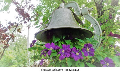 Antique Cast Iron School Bell with Purple Clematis