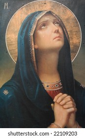antique catholic icon representing virgin mary praying