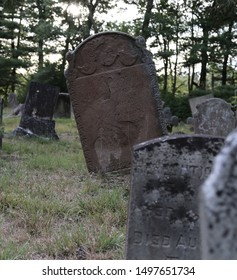 Antique cemetary in New England with gravestones dating back to the 1400's
