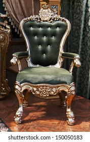 antique chair upholstered in velvet in the interior of the palace