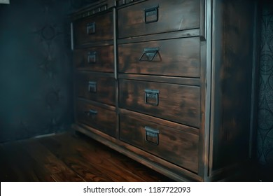 antique chest of drawers / background wooden boxes with handles in vintage wooden furniture wardrobe