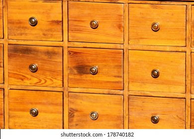 antique chest of drawers in solid wood with brass knobs on sale in antiques shop