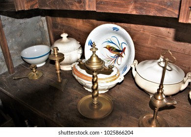 antique chestnut wood furniture with crockery and ornaments in the kitchen of a rural house in Galicia, old wooden furniture, old food storage containers, Galician ethnographic museum,