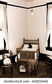 Antique child's bedroom with toys and furniture in sepia.