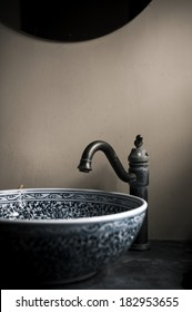 Antique Chinese style washroom with blue-and-white porcelain sink
