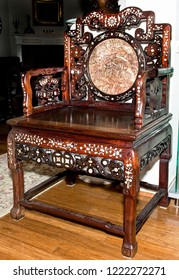 Antique Chinese throne chair with mother of pearl inlays made around 1880.