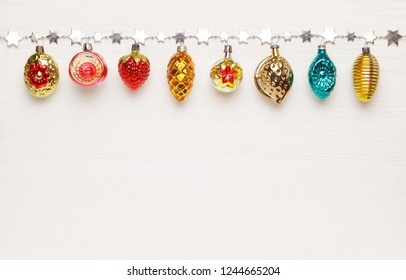 Antique Christmas toys on white wooden background. The concept of new year holidays. Flat lay, top view, copy space