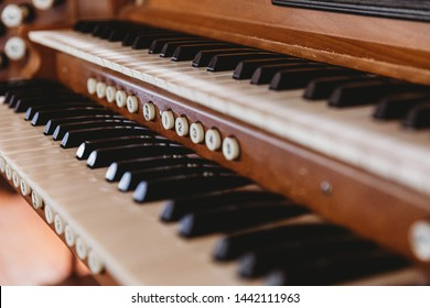 Antique church pipe organ close up. Shallow depth of field