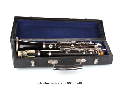 Antique clarinet in case isolated on white