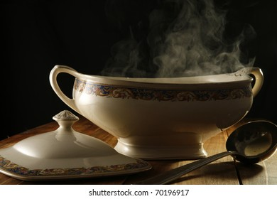 Antique Classical bowl of soup, with steam