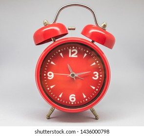 Antique clock and alarm clock.