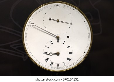 Antique clock, dial and arrows