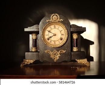 Antique clock in the morning sun