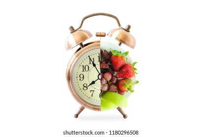 Antique clock needles Fruit on isolated white background . Healthy food concept.
