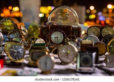 antique clock in the night market of Antiques. clock in camera focus