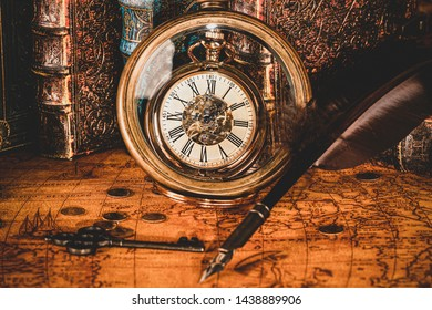 Antique clock on the background of a magnifying glass and books. Vintage style. 1565 old map of the year.