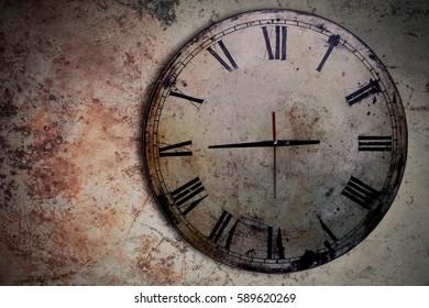 Antique clock on the old concrete floor.