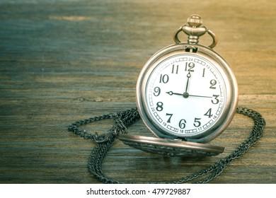 Antique clock vintage on wood background