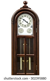 Antique clock with wood carved decoration, isolated on white background