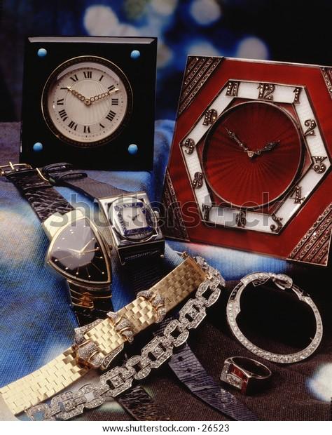 Antique clocks in a still life setting