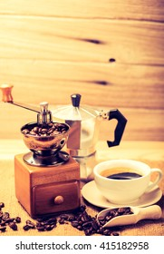 Antique Coffee Grinders with coffee beans and coffee cup in studio short