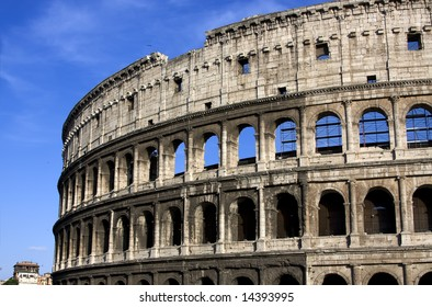Antique colisseum in Rome over blue sky