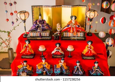 An antique collection of porcelain dolls in colorful silk kimonos representing an ancient king, queen and royal court during the Dolls Festival ('Hinamatsuri') in Japan.